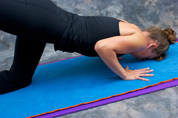 close up of woman doing sunbird yoga pose