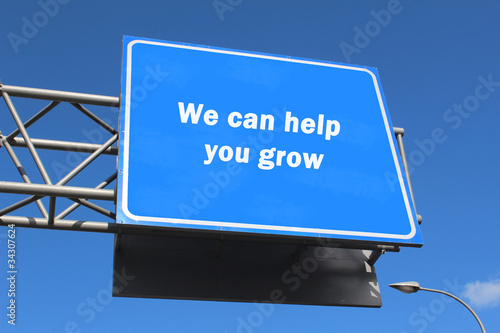 We can help you grow - Highway sign