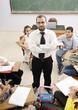 Teacher with children in classroom, boys and girls in school