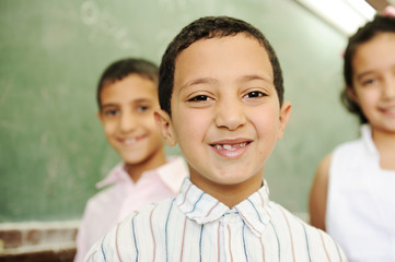 happy children in school, classroom, board