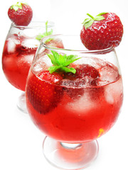 fruit punch cocktail drink with strawberry
