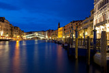 Venice at night on the Canal Grande with view of Rialto bridge