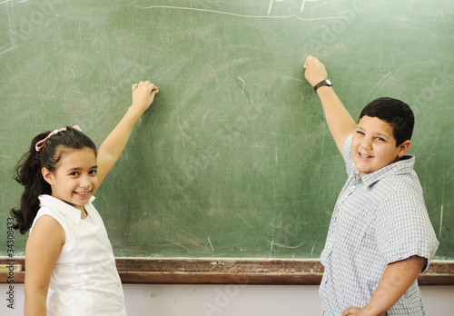 happy children in school, classroom, board
