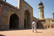 Muslim man walking in Mosque