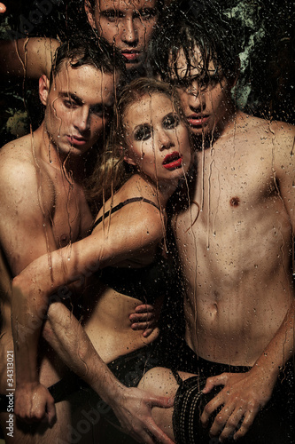 Sexy woman posing with men