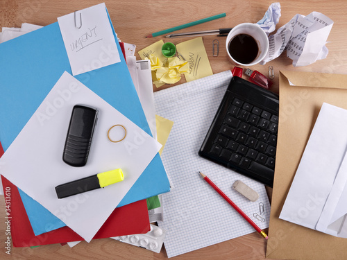 Untidy, messy desk - overwork concept
