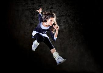 Dancing woman jumping up.