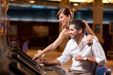 couple playing the slot machine