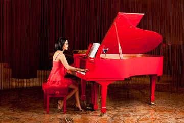 beautiful woman playing the piano