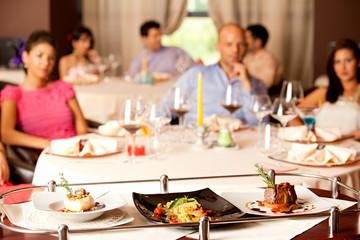 people having meal served in restaurant