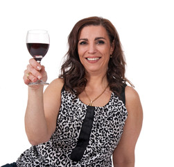 Smiling mature woman with a glass of wine
