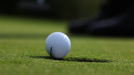 Close up of golf player taking his put