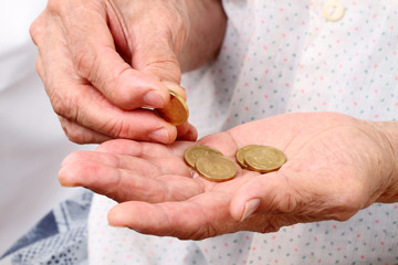 Old woman with coins
