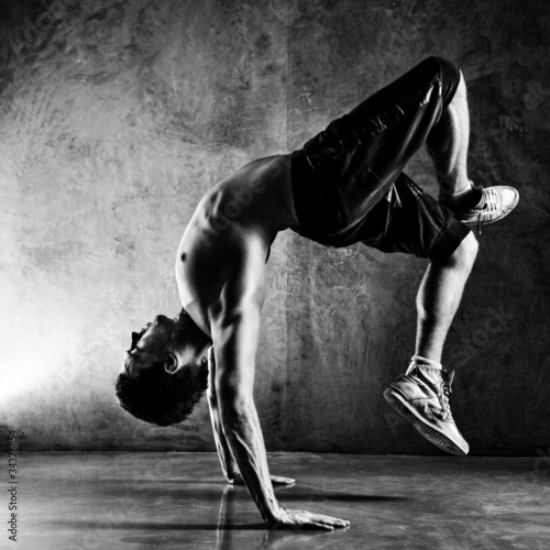 Young man sports exercises - 34326854
