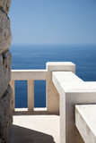 stone viewpoint and banister, ocean view poster