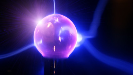 Plasma glass ball creating blue lightnings