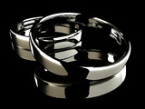 Platinum wedding rings on black background