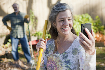 Senior couple outside using smart phone