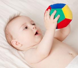 Baby holding a ball