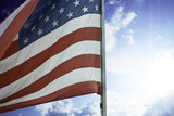 Sun and Clouds over American Flag poster