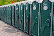 Row of porta potty outhouses ready for use
