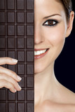 Beautiful woman's face half covered with chocolate