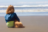 kid and puppy at the beach
