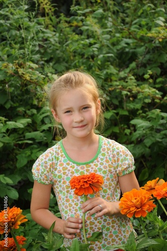 Beautiful girl standing in the flowers