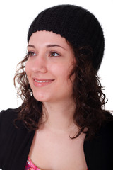 Young Brunette wearing Sock Cap Smiling Looking Up and to Right
