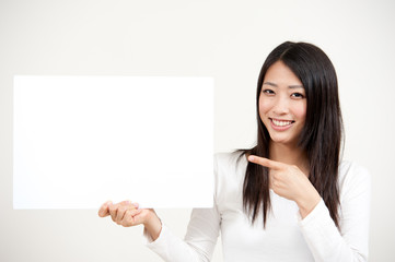 beautiful asian woman holding a blank whiteboad