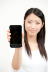 beautiful asian woman showing smartphone