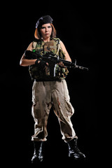 woman in military uniform with weapon