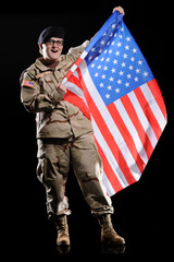 woman in military uniform with flag in the hands