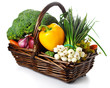 Basket of seasonal fresh vegetables isolated on a white backgrou
