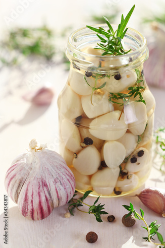 Pickled garlic with spices and herbs