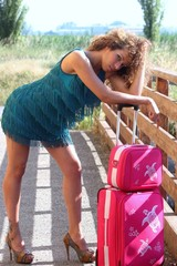 Girl models with suitcase