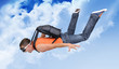 Extreme flight man with a parachute in the clouds - 34346220