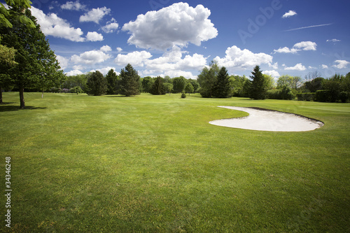 Plexiglas Golf Bunker on golf course and cloudy sky