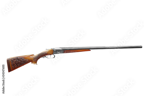 woodcut decorated hunting rifle isolated on white background