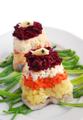 Traditional russian salad with herring, holiday meal