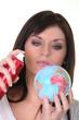 Woman spraying miniature globe