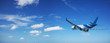 Jet aircraft in a blue sky just after take-off, panoramic shot