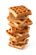 Big pile of fresh Belgian waffles on a white background
