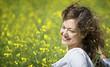 Woman enjoying in rapeseed field