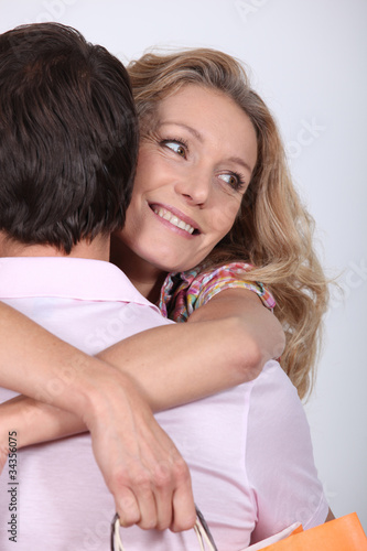 Happy woman hugging her husband