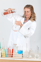 Woman in laboratory conducting experiment