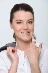 Closeup of a female employee biting her lip