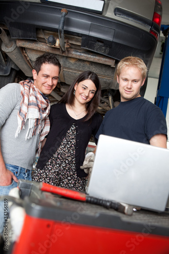 Mechanic Showing Service Order to Customer