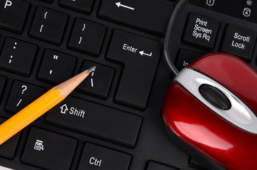 Computer keyboard,mouse and pencil
