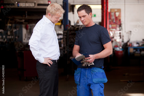 Confident Mechanic with Customer